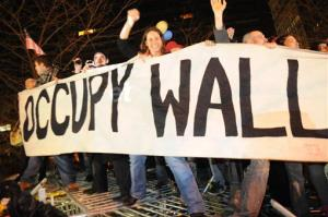 In this Dec. 31 photo, Occupy Wall Street protesters celebrate in Zuccotti Park in New York.