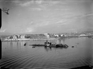 The HMS Olympus in Malta's Grand Harbor, December 1941. It was sunk in May 1942.