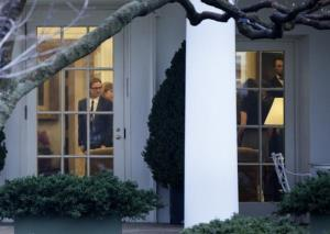 Actor Brad Pitt walks through the Oval Office of the White House after a meeting January 11, 2012 in Washington, DC.