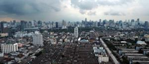 This aerial picture shows clouds looming over the Bangkok skyline on October 16, 2011.