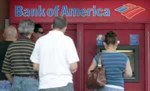 Customers line up at a Bank of America ATM in this file photo.