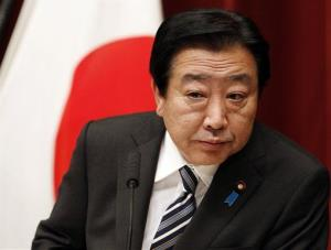 Japanese Prime Minister Yoshihiko Noda listens to a reporter's question during a press conference in Tokyo yesterday.