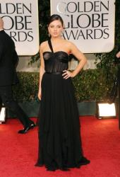 Mila Kunis gets mostly praise. Says @marieclaire, Mila Kunis is SMOKIN' hot in the black Dior gown. It doesn't get much sexier than that, folks.