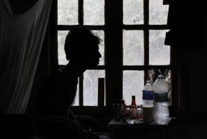 An unidentified tuberculosis (TB) patient sits on his bed at the state TB hospital in Gauhati, India.
