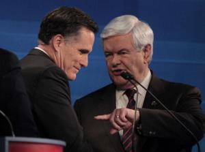 Mitt Romney and  Newt Gingrich talk after the debate.