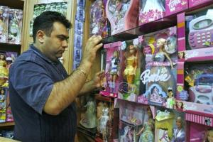 Iranian shopkeeper Hamid Reza Delband displays American Barbie dolls at his shop, in Tehran, Iran,  Monday, April 28, 2008.