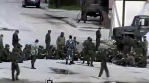 This image from amateur video made available by Shaam News Network on Monday purports to show Syrian security forces in Hama, Syria.