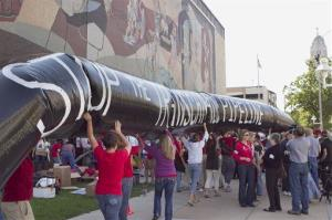 Protesters opposing the Keystone XL pipeline carry a mock pipeline in Lincoln, Neb., in September.
