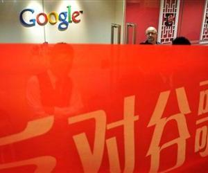 In this Tuesday Nov. 9, 2010 photo, a Google employee is seen behind a banner which reads Anti Google displayed outside the Google's office during a protest in Shanghai, China.
