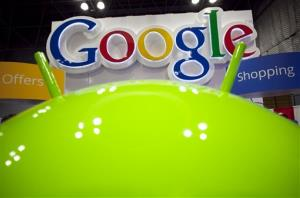 In this Jan. 17 photo, a sign for Google is displayed behind the Google android robot at the National Retail Federation in New York.