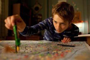 In this image released by Warner Bros. Pictures, Thomas Horn portrays Oskar Schell in a scene from Extremely Loud & Incredibly Close .