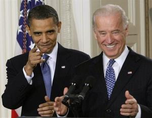 In this March 23, 2010, file photo President Barack Obama and Vice President Joe Biden react to cheers as they arrive in the East Room of the White House in Washington for the health care bill.