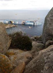 The cruise ship Costa Concordia lies on its side off the Tuscan island of Giglio, Italy, yesterday.