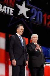 TAMPA, FL - JANUARY 23:  Republican presidential candidates, former Massachusetts Gov. Mitt Romney (L) and former Speaker of the House Newt Gingrich (R-GA) interact prior to the NBC News, National Journal, Tampa Bay Times debate held at the University of South Florida on January 23, 2012 in Tampa, Florida. The...