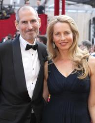 2010 file photo: Steve Jobs and wife Laurene Powell Jobs arrive at the 82nd Annual Academy Awards at Kodak Theater in Hollywood.