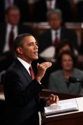 President Obama delivers his State of the Union address yesterday. He's in trouble with Catholic leaders over his decision not to exempt Catholic employers from covering contraception in health plans.