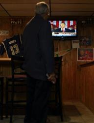 Harry Hall, a member of a group of Republicans known as the Randolph Area Pachyderms, pauses briefly to watch the State of the Union address Jan. 24, 2012, at Nelly's restaurant in Moberly, Mo.