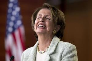 House Minority Leader Nancy Pelosi laughs during a weekly press conference on Jan. 18, 2012.