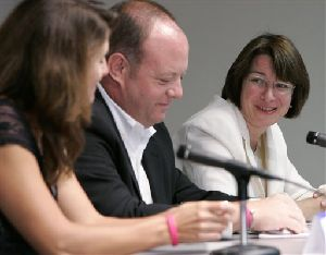 U.S. Sen. Amy Klobuchar, right, thanks Katey Taylor, left, and Scott Taylor, center, parents of Abigail Taylor, during a news conference in Minneapolis, Monday, July 23, 2007.