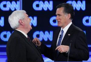 Republican presidential candidates Newt Gingrich and Mitt Romney talk during a commercial break at the Republican presidential candidates debate in Jacksonville, Fla., last night.