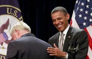 President Barack Obama shares a laugh as he is introduced by Rep. John Larson, D-Conn., before speaking at the House Democratic Issues Conference, Friday, Jan. 27, 2012, in Cambridge, Md.