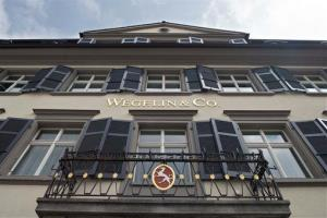 Switzerland's oldest private bank, Wegelin & Co., says it is selling most of its business to the Raiffeisen Group amid a dispute with US. authorities over tax-cheating allegations.