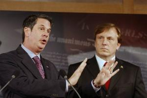 Sen. David Vitter, R-La., left, accompanied by Rep. John Fleming, R-La., gestures during a news conference on Capitol Hill in Washington, Wednesday, March 11, 2009.
