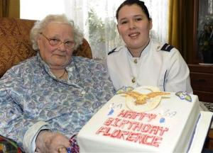 In this Feb. 19, 2010 photo, Florence Green, left, on her 109th birthday, is presented with a birthday cake by LAC Hannah Shaw on behalf of the RAF at her home in King's Lynn, east England.