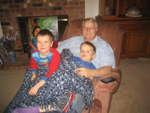Charlie, left, and Braden snuggle with their granddad.