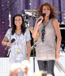Singer Whitney Houston, right, sings with her daughter Bobbi Kristina Brown during a performance for 'Good Morning America' in Central Park on Tuesday, Sept. 1, 2009 in New York.