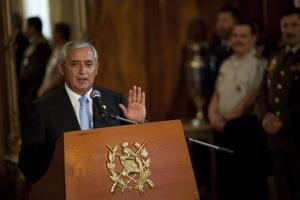 Guatemala's President Otto Perez Molina answers a question during a joint news conference with El Salvador's President Mauricio Funes yesterday.