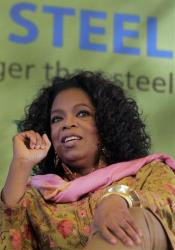 Oprah Winfrey reacts during an interview in a session at the Jaipur Literature Festival in Jaipur, in the western Indian state of Rajasthan, India, Sunday, Jan. 22, 2012.