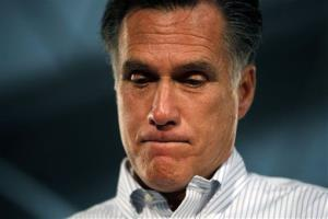 Mitt Romney, pauses to reflect on an answer during campaign rally in Kentwood, Mich., yesterday.