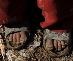 An Afghan girl's feet are seen in a refugee camp in this file photo.