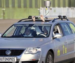 A driverless car which from the outside looks like a regular Volkswagen Passat with a camera on top, is seen being put through its paces at Berlin's disused Tempelhof airport, October 13, 2010.