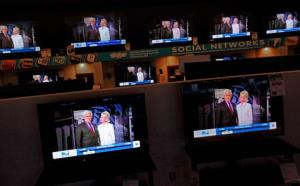 Dozens of televisions display a political advertisement with the image of Newt Gingrich and his wife Callista Gingrich at the American furniture electronics and appliances store December 27, 2011, in Urbandale, Iowa.