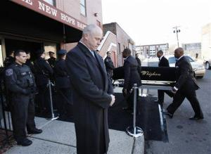 A coffin holding the remains of singer Whitney Houston is carried into the New Hope Baptist Church.