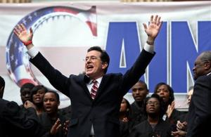 Stephen Colbert sings to the crowd during the Rock Me Like a Herman Cain South Cain-olina Primary Rally at the College of Charleston in Charleston, SC, on Friday, Jan. 20, 2012.