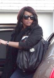 Bobbi Kristina Houston Brown arrives at Whigham Funeral Home for a private viewing for her mom, Whitney Houston, in Newark.