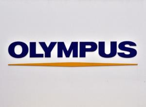 An Olympus logo is displayed at the company's showroom in Tokyo.