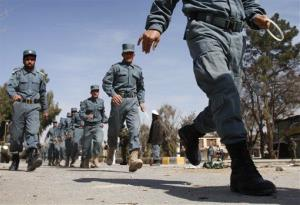 Afghan policemen head toward an anti-U.S. demonstration east of Kabul Saturday.