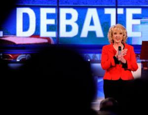 Arizona Gov. Jan Brewer appears on stage before a debate at the Mesa Arts Center between Ron Paul, Rick Santorum, Mitt Romney and Newt Gingrich on February 22, 2012.