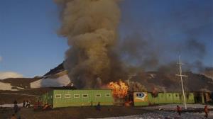 Fire and smoke rise from Brazil's Comandante Ferraz station in Almirantazgo Bay, in the South Shetland Islands of Antarctica.