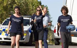 In this photo provided by Greenpeace, Lucy Lawless, center, and two Greenpeace activists leave the police station in New Plymouth, New Zealand, Feb. 27, 2012, after their release on bail.