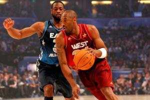 Kobe Bryant of the Los Angeles Lakers and the Western Conference drives against Dwyane Wade of the Miami Heat and and the Eastern Conference during the 2012 NBA All-Star Game.