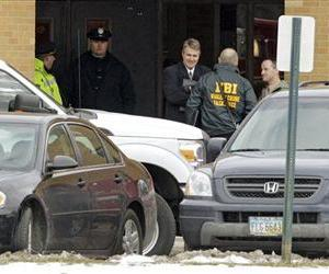 Investigators congregate at a rear entrance to Chardon High School in Chardon, Ohio Monday, Feb. 27, 2012.