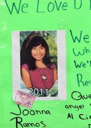 A photo of Joanna Ramos, 10, with a note,  is left at a memorial outside Willard Elementary school  in Long Beach, Calif. on Monday Feb. 27, 2012.