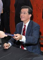 Stephen Colbert signs autographs for fans on June 24, 2011 in New York City.