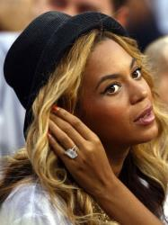 Beyonce watches Rafael Nadal of Spain and Novak Djokovic of Serbia play during the 2011 US Open.
