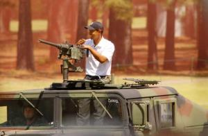 Tiger Woods arrives in a Military Humvee through red smoke to start a golf exhibition  at Fort Bragg, North Carolina after spending a week training with troops in 2004.
